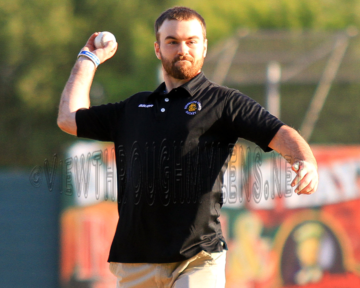 Bulldog Captain and Hobey Baker Winner Jack Connolly throws out the first pitch Thursday for the Duluth Huskies