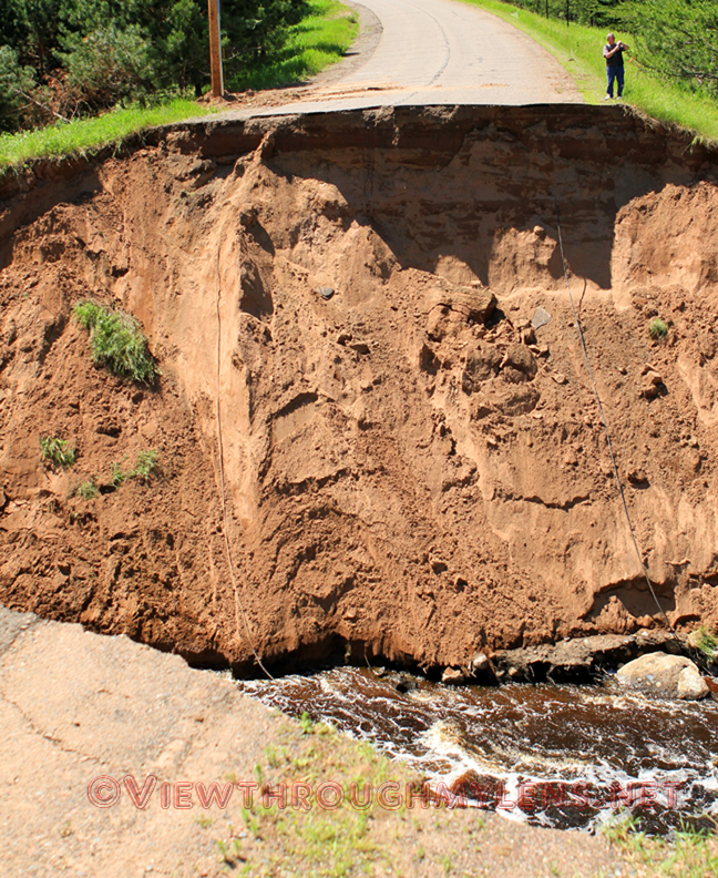 Giant washout/hole in Reservation Road