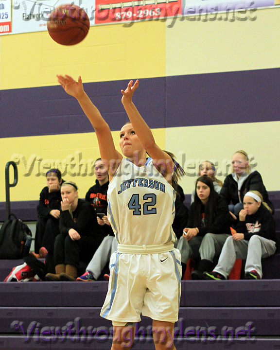 Bloomington Jefferson's Brooke Fritzlar fires up a three from the corner on Friday.