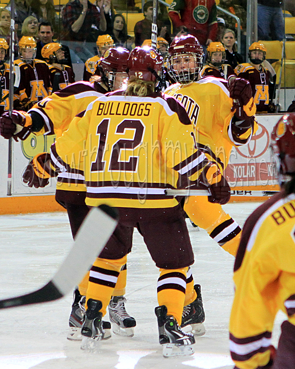 Jenna McParland celebrates her game tying goal with Tea Villila (left) and Haley Irwin.