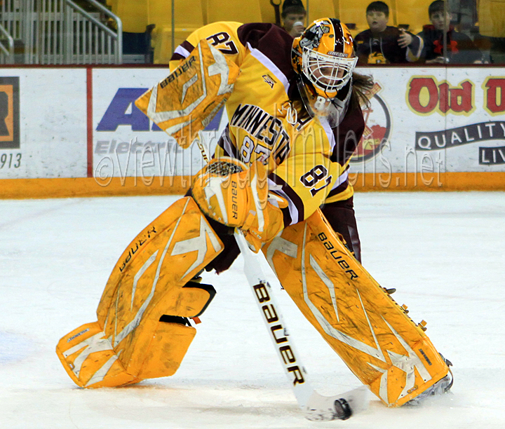 UMD Goaltender Jenny Harss plays the puck vs Ohio State