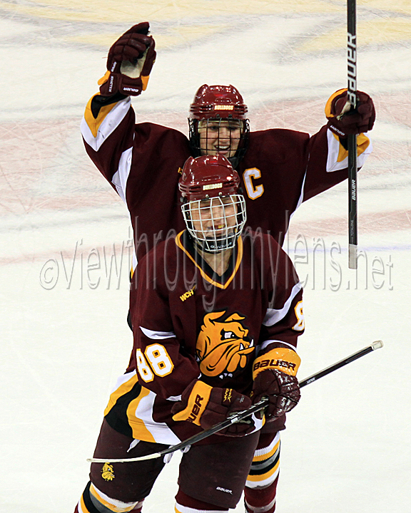 Kacy Ambroz celebrates Brigette Lacquette's shorthanded empty net goal to ice the game vs Wisconsin