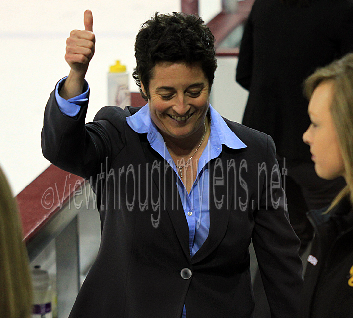 Head Coach Shannon Miller gives a thumbs up to the crowd after UMD's win Friday